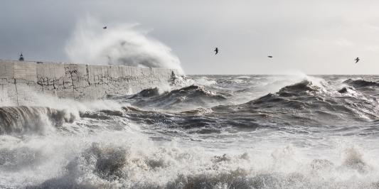 Waves overcoming Newhaven breakwater